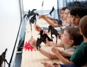 Primary students taking part in a shadow puppetry workshop in London. July 2012